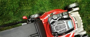 Red lawnmower on green grass - OPE Repair Parts Market Share