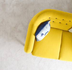 image of a yellow, curved sofa